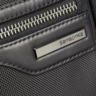Ballistic nylon body with soft cowhide leather details and premium gunmetal hardware.